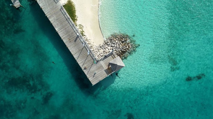 Sharks at the dock Exuma Cays Exumas Highbourne Cay Travel Destinations DJI X Eyeem Dronephotography Bahamas EyeEm Selects High Angle View Water Turquoise Colored Day No People Swimming Pool Directly Above Nature Sea Outdoors Blue Aerial View Green Color Tranquility Transparent Luxury Beach