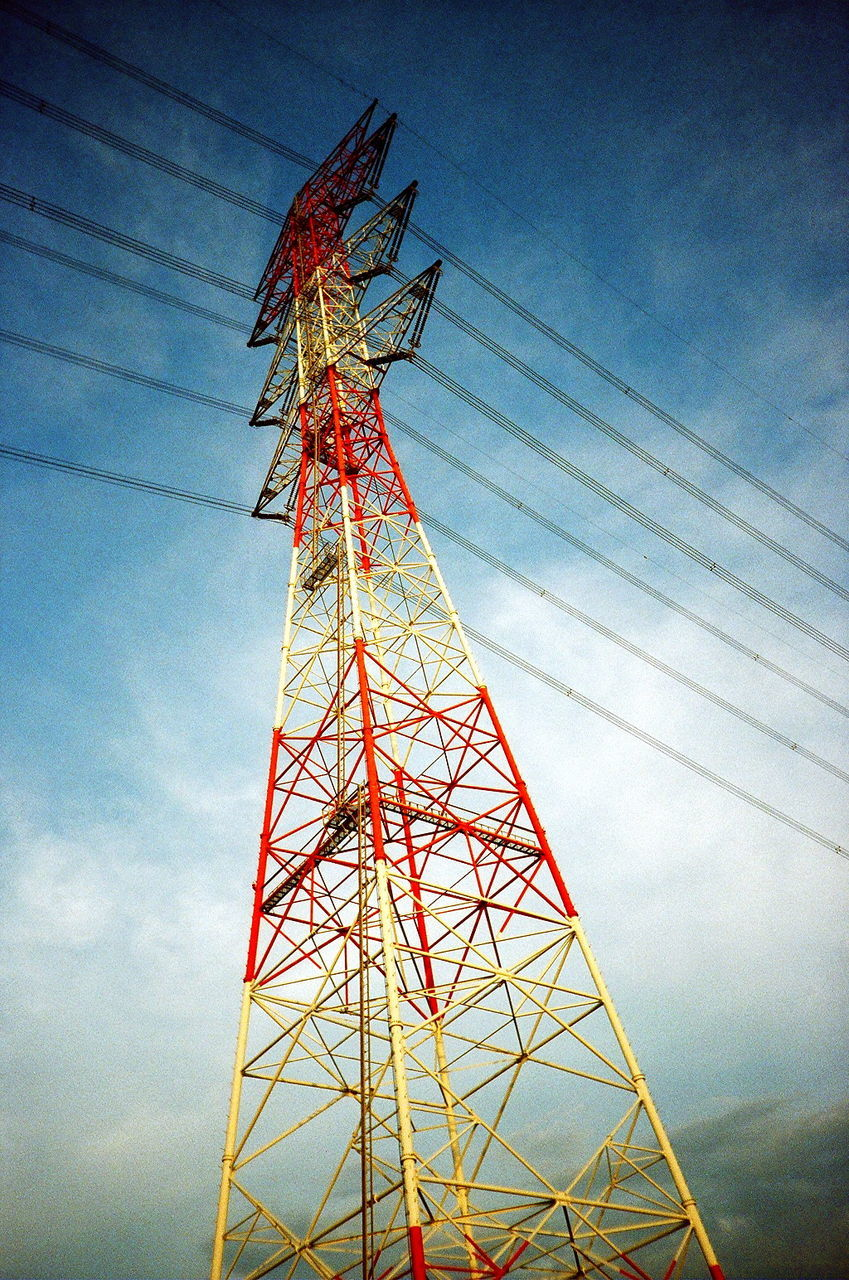 electricity pylon, low angle view, cable, technology, tower, electricity, sky, connection, fuel and power generation, power supply, no people, power line, cloud - sky, communication, day, tall, global communications, built structure, steel, outdoors, tree, architecture, nature
