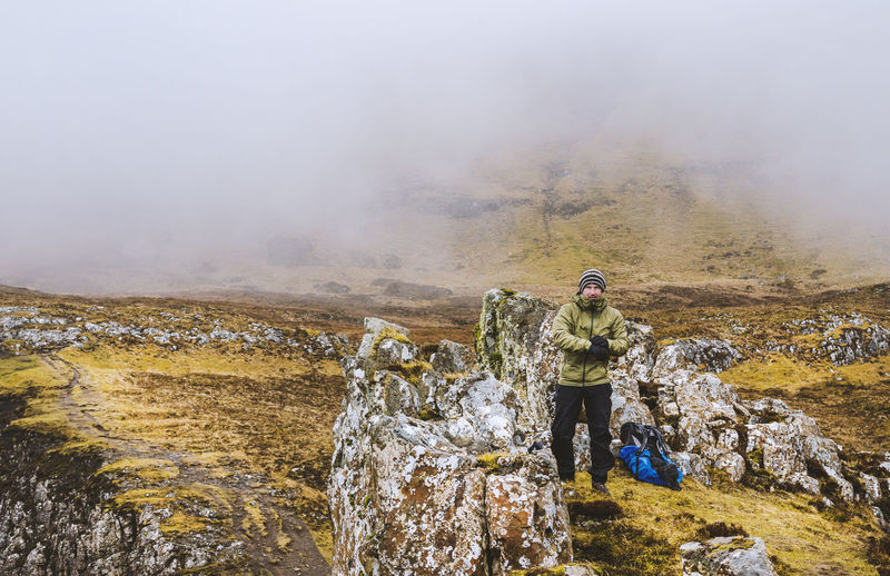 Full Length Of Man Hiking On Quirang Hill During Foggy Weather