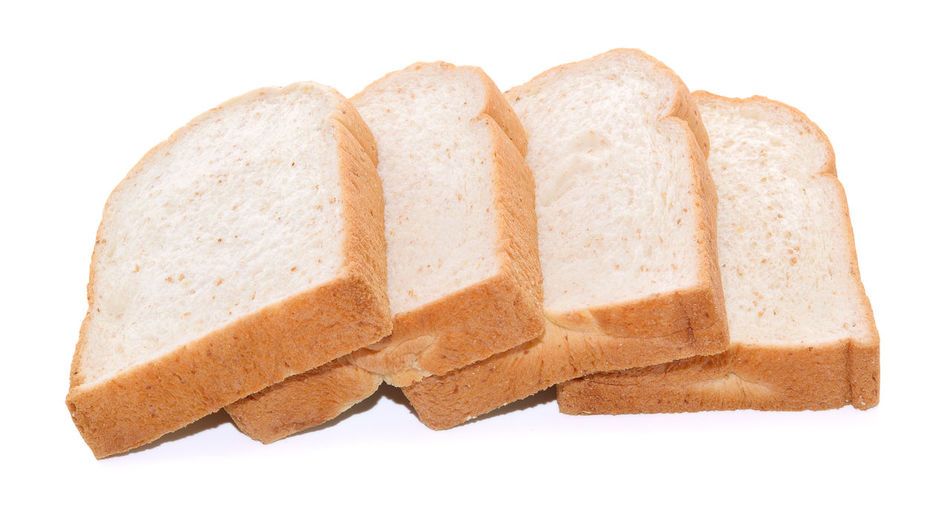 Close-up of breads against white background