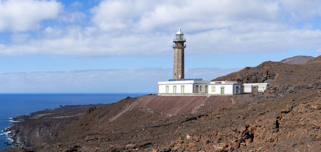 Lighthouse Faro de Orchilla on the island of El Hierro, Canary Islands, Spain. Architecture Beacon Canary Islands El Hierro Faro De Orchilla Lighthouse Lonely Maritime Panoramic SPAIN Travel Attraction Building Coast Destination Landmark Landscape Lava Marine Navigation Sea Sight Tourism Tower Volcanic