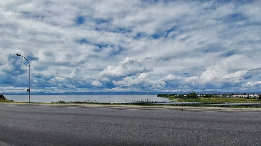 Cloud - Sky Sky Road Transportation Street Beauty In Nature Nature Day Scenics - Nature City No People Tranquility Asphalt Tranquil Scene Water Environment Plant Airport Land Outdoors