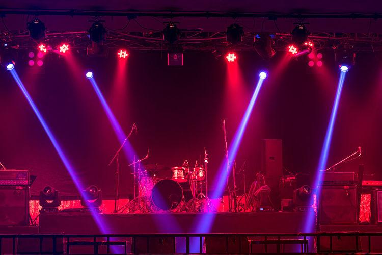 Illuminated christmas lights at music concert at night