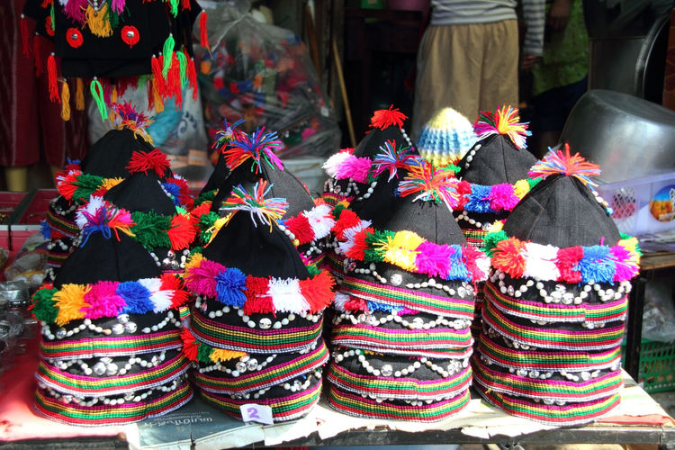 Multi colored hats for sale in store