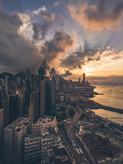 Finally, I'm back. Sunset Cityscape Architecture Building Exterior Cloud - Sky Urban Skyline No People Skyscraper City Built Structure Outdoors Business Finance And Industry Sky Aerial View Travel Destinations Sea Day Water The Street Photographer - 2017 EyeEm Awards