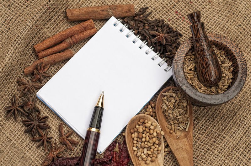 Menu background. Recipe notepad with diversity of spice and herb.