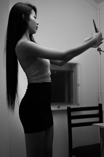 Beautiful Woman Taking Selfie With Mobile At Home