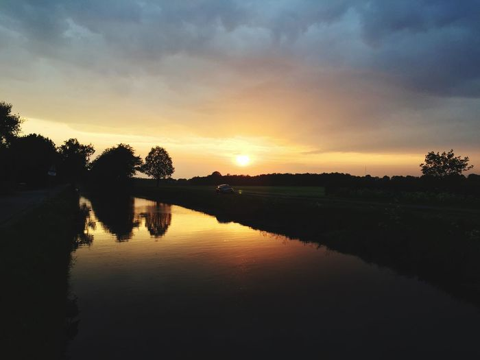 Sunset Reflecting On A Dutch Canal Dutch Landscape Sunset Sky Reflection Water Tree Scenics - Nature Tranquil Scene Orange Color Cloud - Sky Idyllic Non-urban Scene Outdoors First Eyeem Photo EyeEmNewHere