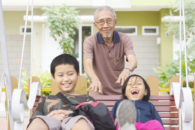 Adult Care Child Childhood Emotion Family Front View Grandchild Grandfather Happiness Innocence Lifestyles Males  Mature Men Men Portrait Real People Senior Adult Senior Men Sitting Smiling Togetherness Two People