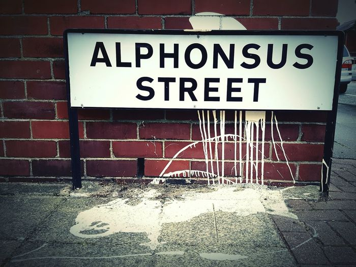 This Is Old Traffordday 21. Street Sign Road Name Spilt Paint Drips  Red Brick Wall Makes Me Smile Makes Me Smile Everytime :) Street