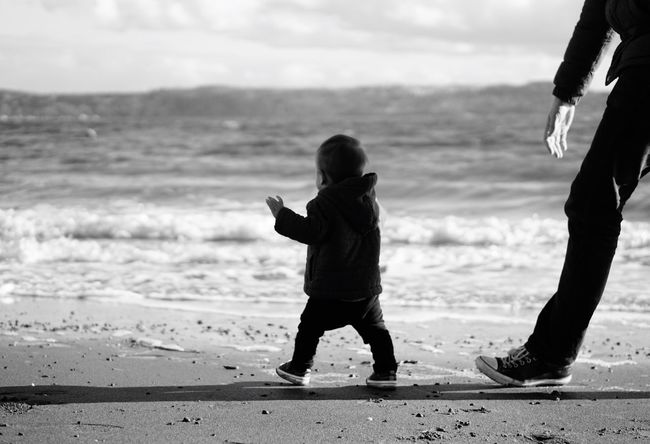 Will always be your back up. Beach Sand Shore Childhood Water Boys Wave Togetherness Nature Sky Daddy And Son