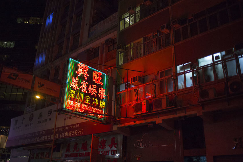 Hong Kong HongKong Advertisement Architecture Building Building Exterior Built Structure City Commercial Sign Communication Illuminated Information Low Angle View Neon Night Nightlife No People Non-western Script Script Sign Store Sign Street Text Western Script
