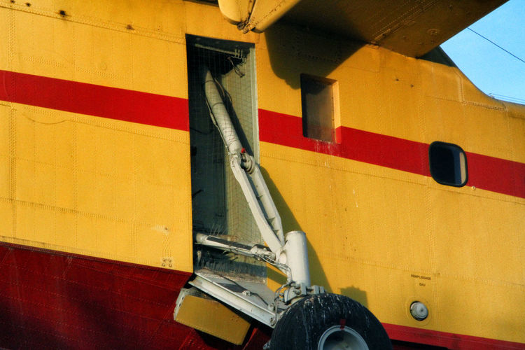 Low angle view of yellow airplane