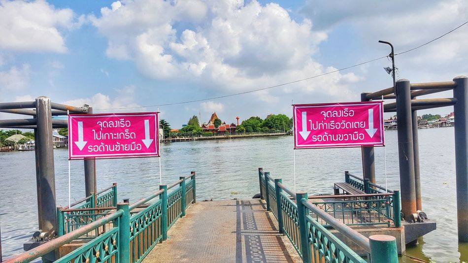 Thailand EyeEm Travel Text Railing Cloud - Sky Outdoors Sky Day Hanging Message Travel Destinations Communication No People Placard City Water Architecture Nature Ko Kret Kokret Kohkret Travel In Thailand