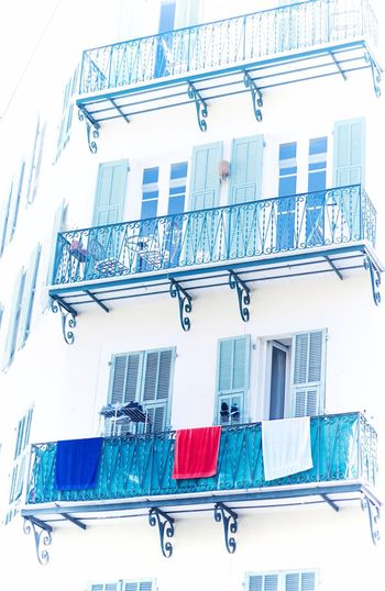 towels drying on a balcony, forming the french flag France French French Riviera Côte D'Azur Balcony Window Architecture Building Exterior Building Daylight Streetphotography Street Photography City City Life Cityscape City Street Highkey High Key Street Life Towel Red White Blue Flag National Flag