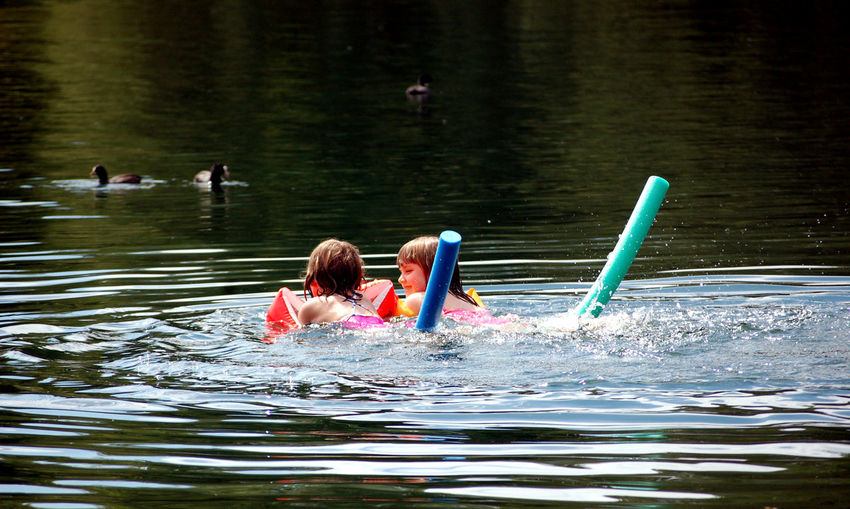 Children Innocence Relaxing Child Childhood Day Floating On Water Girls Headshot Holiday Inflatable  Lake Leisure Activity Lifestyles Nature Outdoors Rippled Swimming Togetherness Trip Vacations Water Waterfront