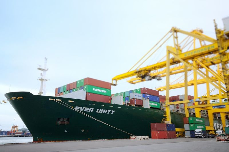 Apron Bussiness Container Crane - Construction Machinery Economic Engineering Export Gantry Cranes Import Land Vehicle Loading Logistics Marine Port Quay Gantry Cranes Sea Ship Street Terminal Transport Transportation Truck Vessel World Yard