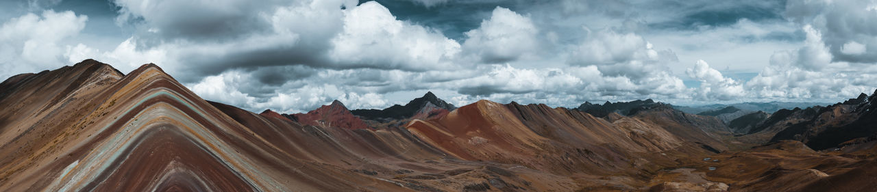 The unbelievable view from Vinicunca, Rainbow Mountain. Ausangate Colours Latin America Minerals Nature Panoramic Rainbow Mountain Adventure Arid Climate Cloud - Sky Environment Extreme Terrain Geology Idyllic Landscape Moody Mountain Range Non-urban Scene Outdoors Overcast Rainbow Remote South America Tranquil Scene Travel Destinations