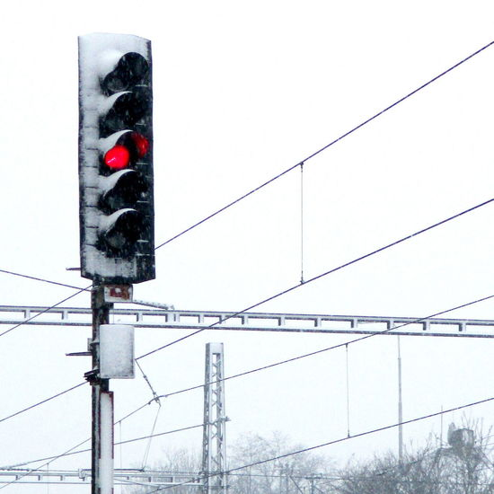Cable Clear Sky Day Electricity  Electricity Pylon Guidance Low Angle View No People Outdoors Red Light Sky Stoplight Traffic Signal Transportation