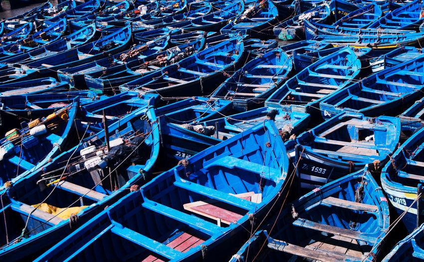 High angle view of fishing boats moored at harbor