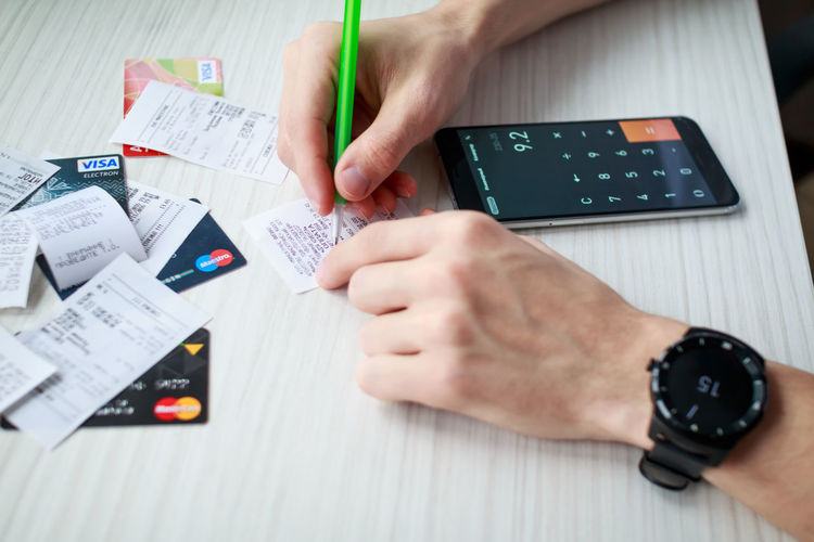 Calculator Watch MasterCard Visa Maestro  Check Bill Costs Money Expenses Payment Business Card Payment System Payments Credit Card Pen Banking Human Body Part Portable Information Device Mobile Phone Wireless Technology Onlineshop Finance And Economy Business Finance And Industry