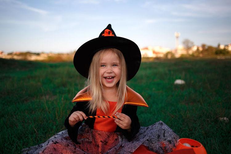 Portrait of cute smiling girl on field