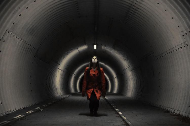 Full length of man standing in tunnel