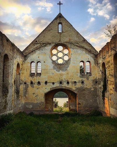 Architecture Built Structure Arch Building Exterior Religion History Spirituality Place Of Worship Cloud - Sky Cross No People Day Window Outdoors Sky Bell Tower
