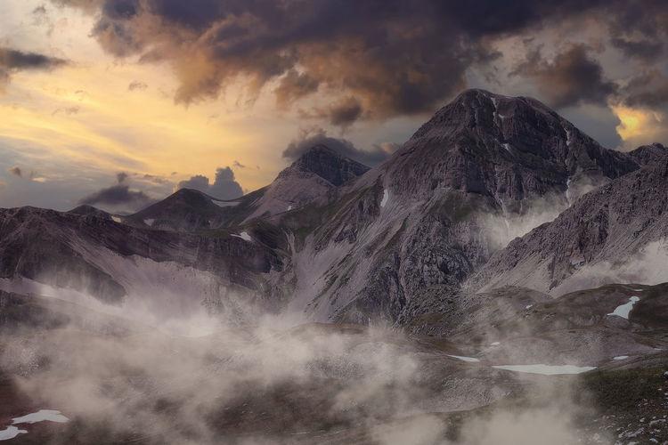 Mountain area of the monti della laga at sunset with fog
