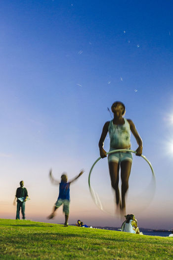 Blue Childhood Clear Sky Endless Summer Full Length Grass Hula Hoop Girl Hula Hooping  Hula Hooping Fun Hula Hoops Lifestyles Live For The Story Motion Outdoors Running Sky The Street Photographer - 2017 EyeEm Awards Sommergefühle