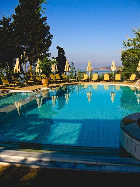 Dive straight in! Lourdes Kefalonia Kefalonia, Greece Edit Water Pool Swimming Pool Tree Blue Plant Sky Nature Clear Sky Day Poolside Tourist Resort Reflection No People Travel Destinations Architecture Built Structure Outdoors Sunlight Luxury