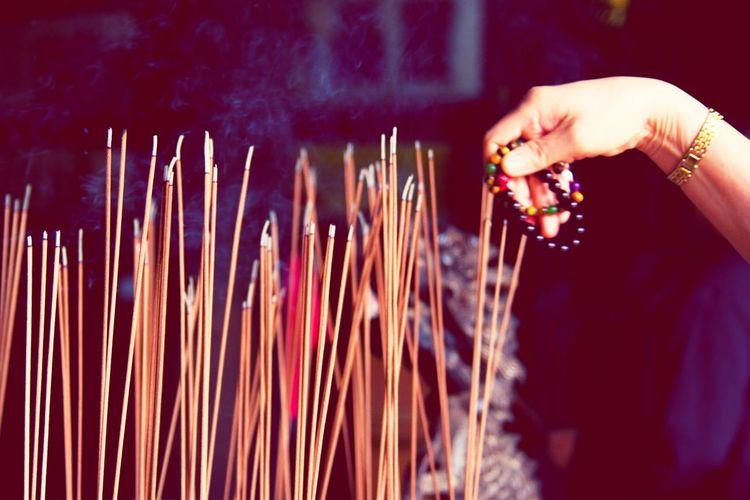 祈求平安 Sacrifice Religion Spirituality Human Hand Burning Human Body Part One Person Place Of Worship Outdoors Real People