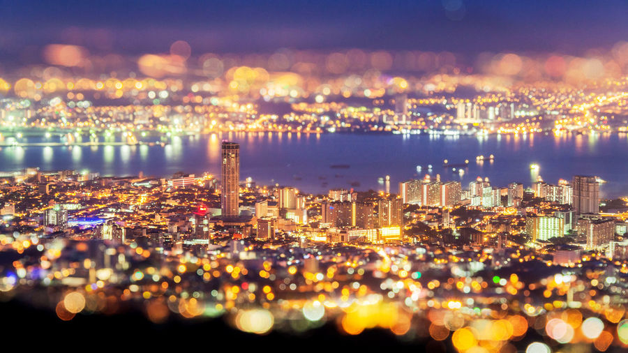 View of illuminated city at night