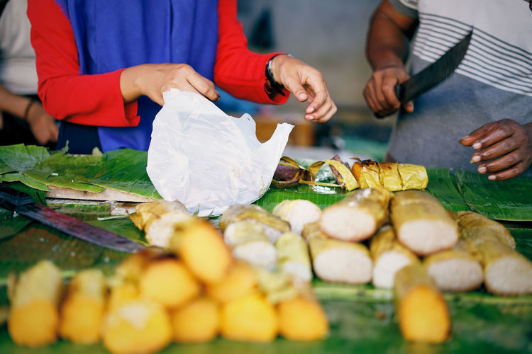 High angle view of people preparing food at market stall