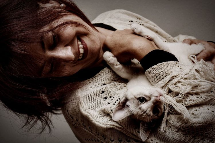 Portrait of woman holding a cat