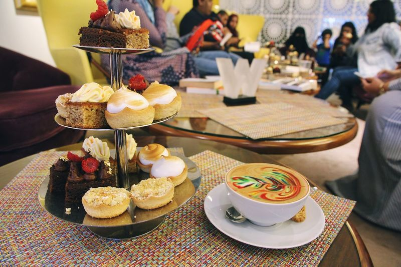 Rainbow Coffee with lovely people at book swap meetup W Hotel Meetup Aternoon Tea Rainbow Coffee Coffee Table Plate Incidental People Freshness Focus On Foreground Dessert Cake Restaurant Indoors  Still Life