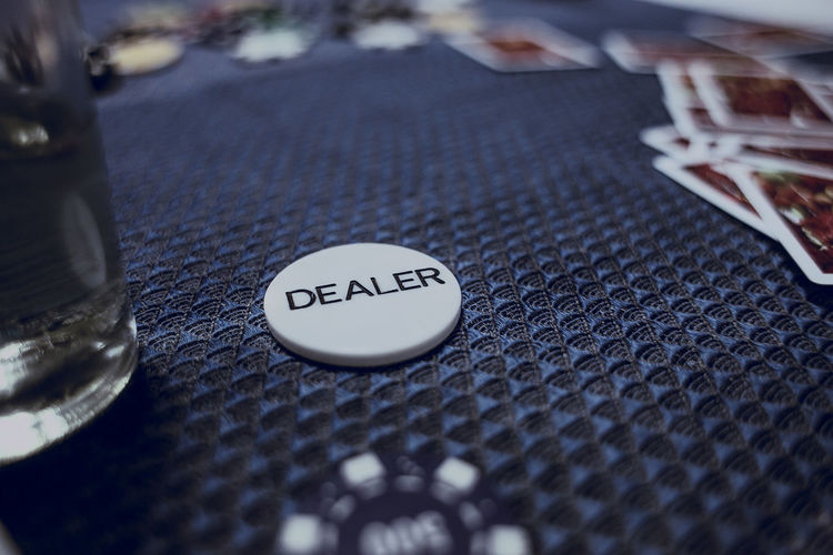 High angle view of dealer coin on table