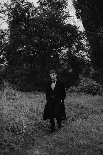 a Young Man walking in a field EyeEm Best Shots Fashion Field Grass Man Nature Retro Well Dressed Blackandwhite Landscape Lifestyles Outdoors People Portrait Portrait Photography Vintage Walking