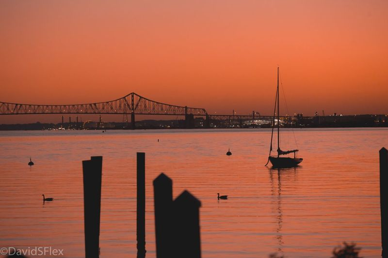 EyeEm Selects Sunset Bridge - Man Made Structure Water Sea Travel Destinations Suspension Bridge Connection Outdoors Sky Beauty In Nature Day Horizon Over Water Nature Built Structure Transportation Architecture No People Nautical Vessel Silhouette Beach First Eyeem Photo