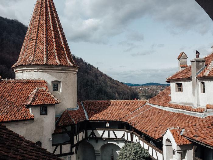 Roof of buildings in town against sky