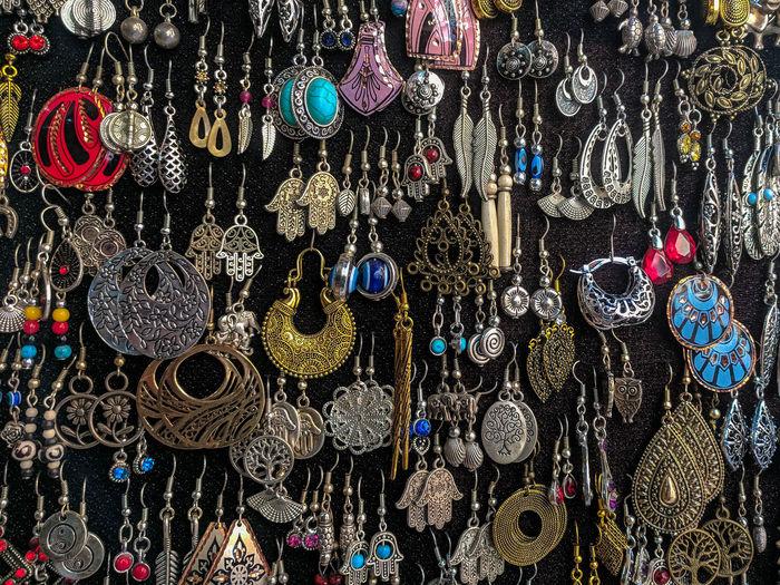 Full frame shot of various earrings for sale in store