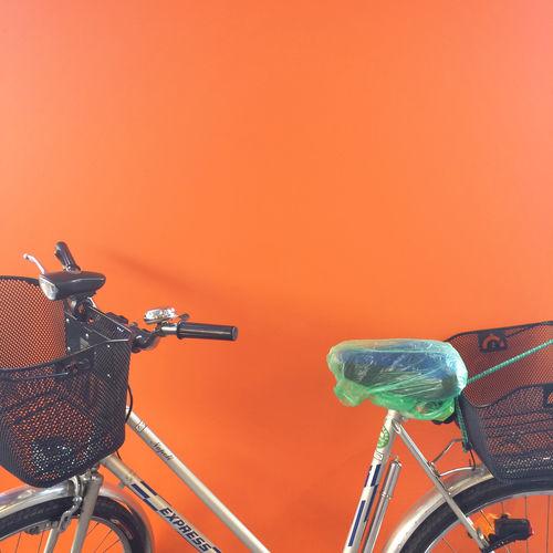 Close-up of bicycle against orange sky