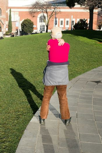 Woman standing on footpath