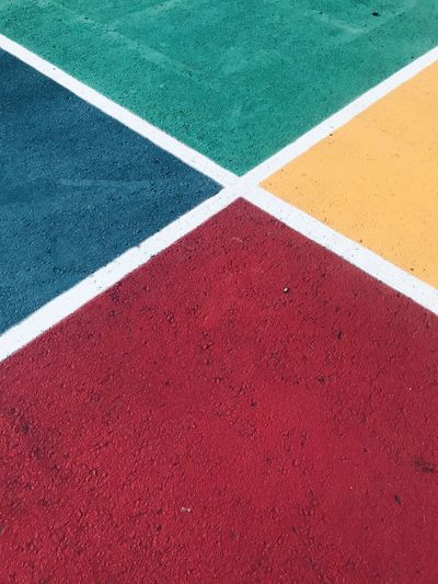 High angle view of road marking on color field