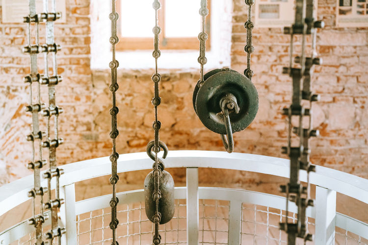 Pulley system inside the church tower Metal Focus On Foreground Close-up Day Chain No People Old Architecture Built Structure Pulley Iron Tower Metal Industry System Lift Round Inside Bricks Architecture Medieval Medieval Architecture Inside The Tower Visiting History Museum