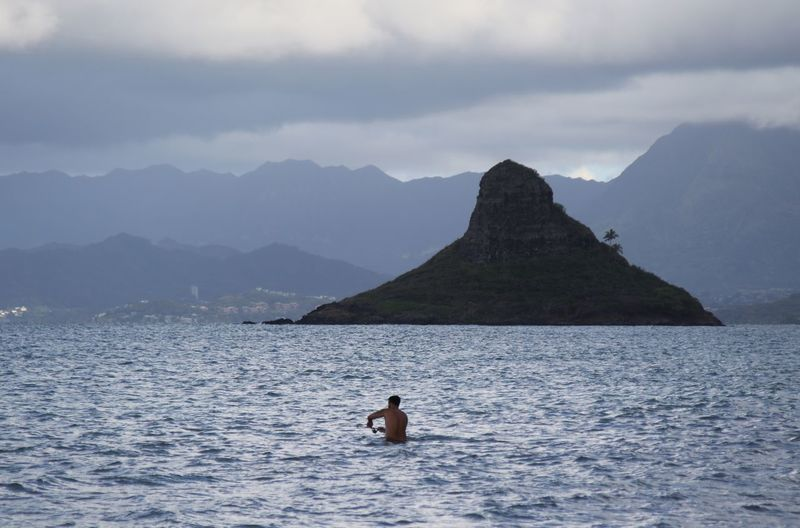 Rear view of man in the sea