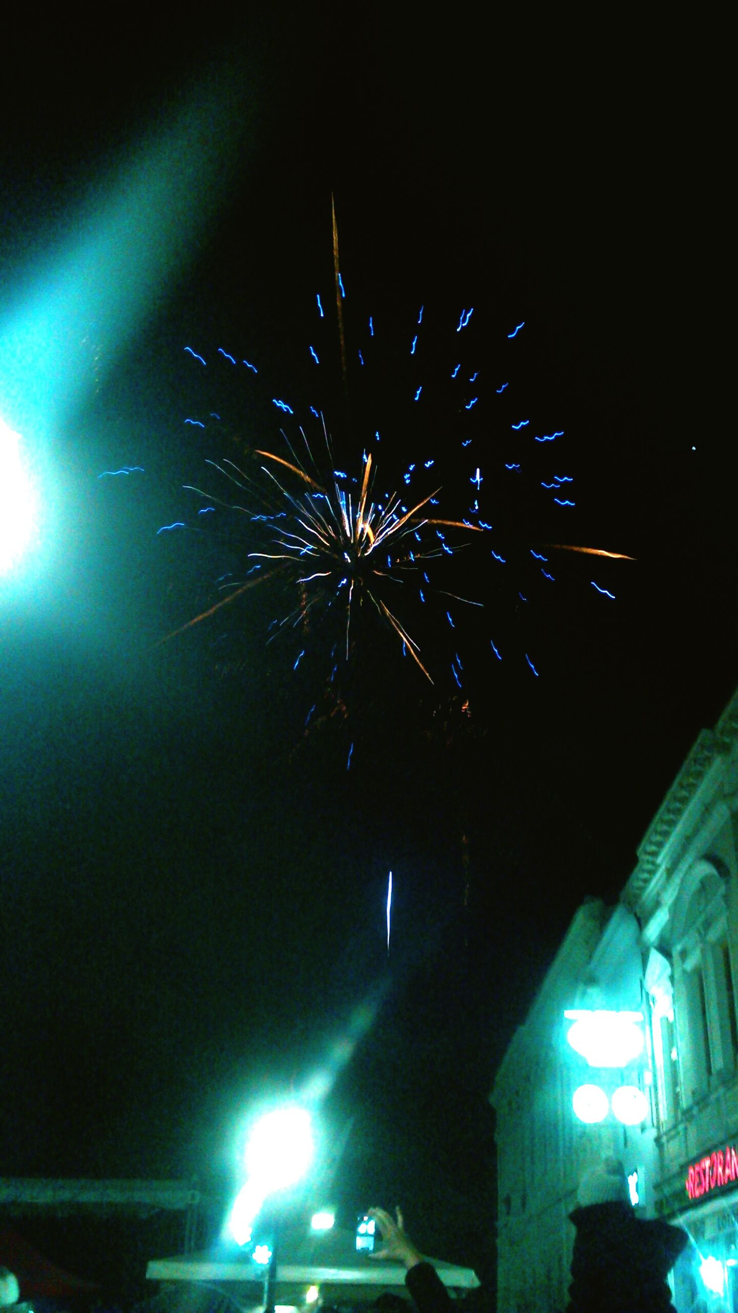night, illuminated, celebration, arts culture and entertainment, low angle view, event, firework display, multi colored, motion, exploding, no people, building exterior, outdoors, firework - man made object, sky, architecture, firework