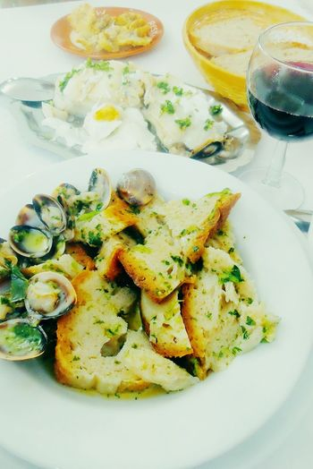 Typical Alentejo dish Portugal Alentejo Bread Soup plate Garlic Pennyroyal Cilantro Egg COD Clamshell oliveoil Wine