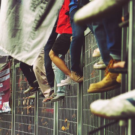 Spectators at Games of New Emerging Forces footbal stadium, Senayan Jakarta Mayday  Jakarta GBK Soekarno INDONESIA Perspective Selected People Phone Photooftheday Bestoftheday News Kompas Football