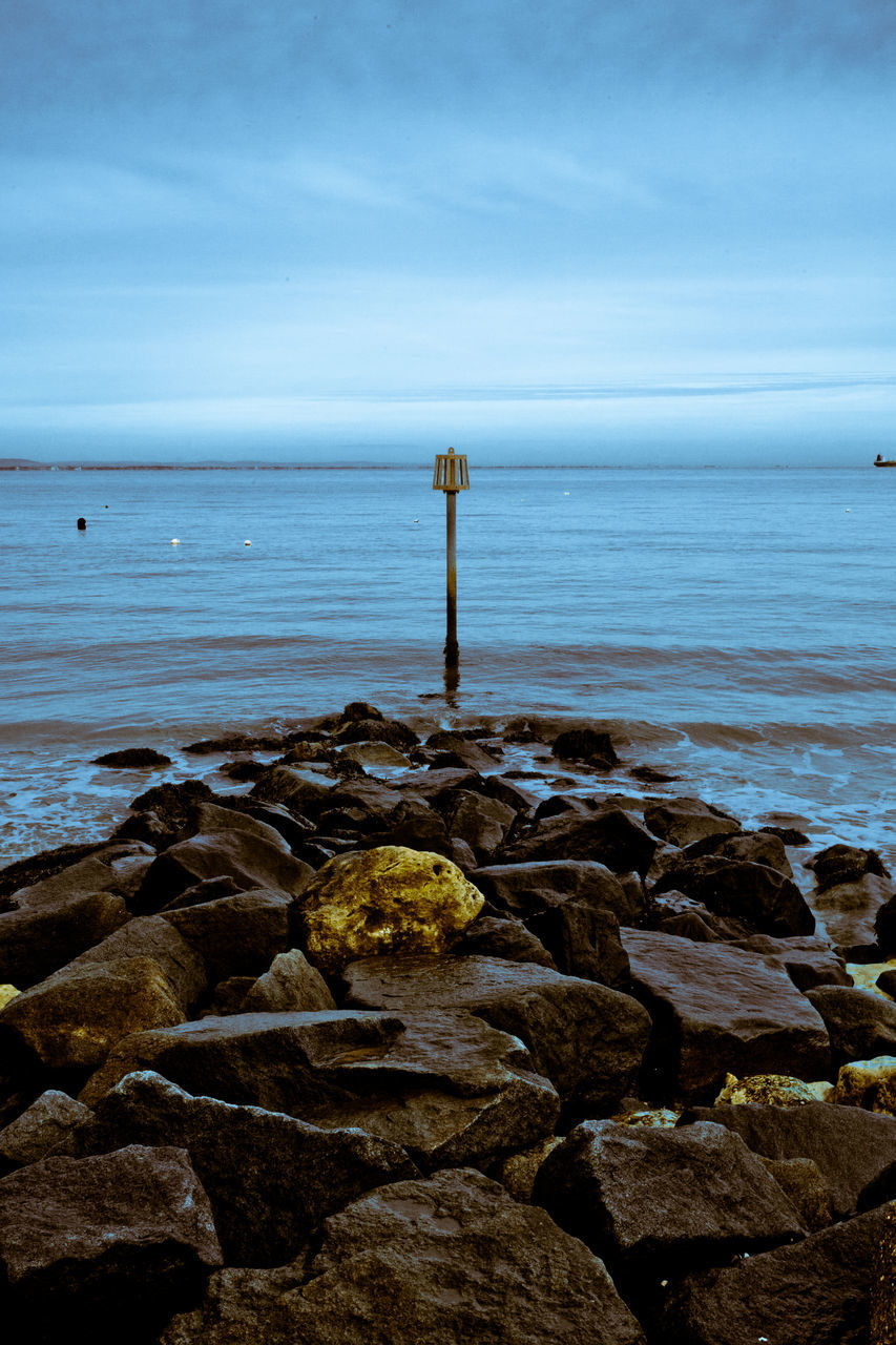 sea, water, horizon over water, rock - object, tranquility, tranquil scene, beauty in nature, nature, scenics, day, no people, outdoors, beach, sky